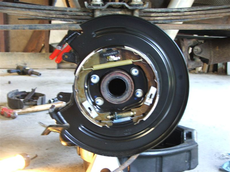 Clean Up The Axle Housing Surface And Install The New Disc Brake Backing Plate Parking Brake Assembly Reassembly Was With Nuts And Bolts As Well